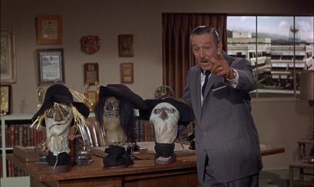 Walt Disney with SCARECROW masks on his desk